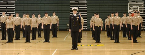 "Junior Lance Youtsey (center) stands at attention in front of other JROTC students Wednesday during annual inspection. Youtsey said he went into ROTC because he's always wanted to go into the coast guard, but his favorite part about ROTC is the people. ""It makes my day, they're actually pretty funny,"" said Youtsey. Photo by McKenna Click."