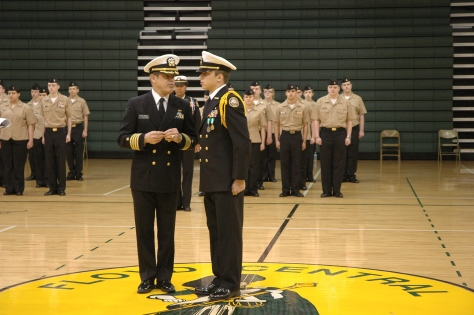 Senior George Emily stands and listens as Captain Tim Naville inspects him during NJROTC's annual inspection that was held Wednesday morning in the gym. This is the 20th annual inspection since 1994. Photo by McKenna Click.