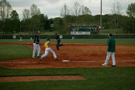 Junior Mike Springer runs through first base. Photo by Noble Guyon.