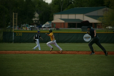 Senior Connor Curry makes a run for third base. Photo by Noble Guyon.
