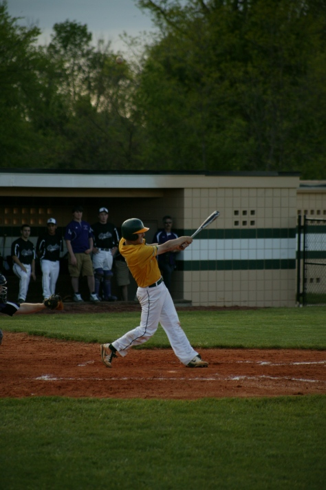 Senior Jacob Snodgrass hits the ball. Photo by Noble Guyon.
