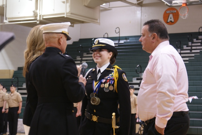 Junior Alyson Gill accepts the position of Cadet Commander from Lieutenant Colonel Gipe on May 7. Photo by Ashley Vance.