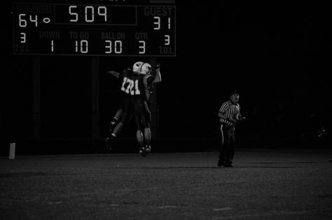 Senior Brandon Stout and Austin Carl celebrate after Stout's touchdown. Photo by Noble Guyon.