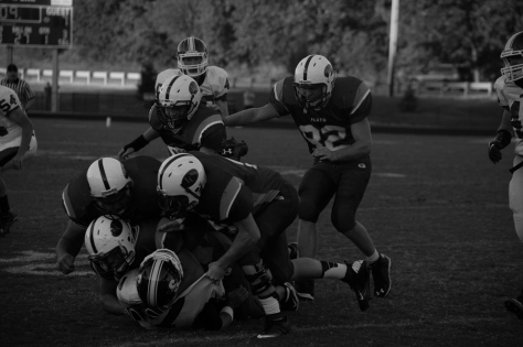 Multiple FC players stack on top of the Seymour quarter back. Photo by Noble Guyon.