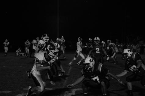 Senior Brandon Stout prepares to tackle a Seymour player. Photo by Noble Guyon.