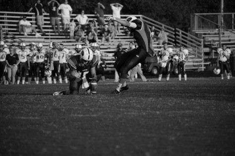 Senior Ryan Lenz takes the kick to score an extra point for the Highlanders. Photo by Noble Guyon.