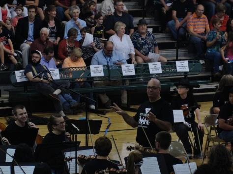 Orchestra director Doug Elmore directs the FC Symphony Orchestra during the Orchestra Rocks concert.