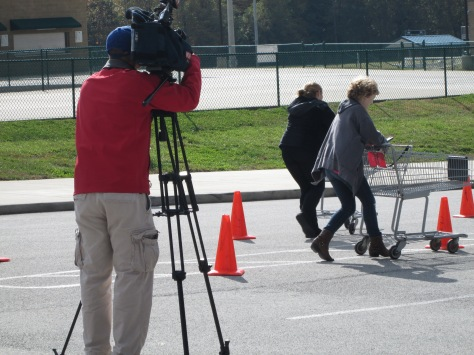 Fox41News camera man shoots footage of sophomore Alexis Moody beating her opponent in a race. Photo by Rachel Lamb