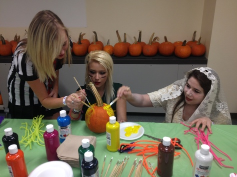 Juniors Emily Shumate, Sequoia Bryant, and Lexie Byrd decorate a pumpkin for the contest.