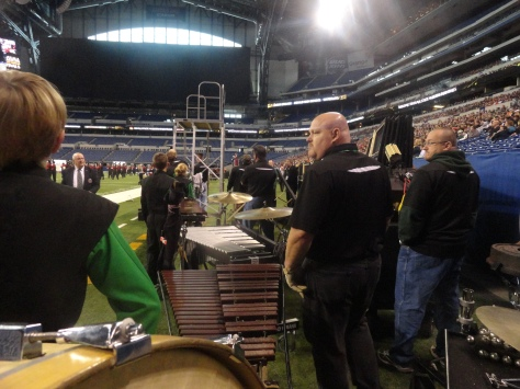 10:20 a.m. The Pit arrives on the sideline to prepare to set up after DeKalb High School finish performing.