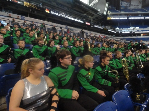 11:25 a.m. After performing sophomore Phoenix-Grace Lackey and Chris Harbeson sit with the band watching the rest of the bands perform for State Finals.