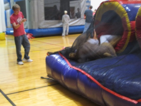"Junior Jacob Huntley calls a child out for ""rough-housing"" on the blow up obstacle course. Photo by Rachel Lamb"