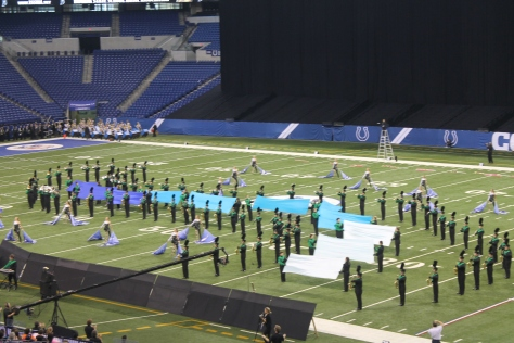 10:40 a.m. Time for performance. The marching band runs a nine minute show to compete for the top ten in State Finals.