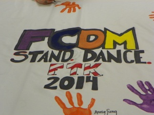 FCDM participants add their handprints to the banner throughout the afternoon. Photo by Jonathan Blaylock.