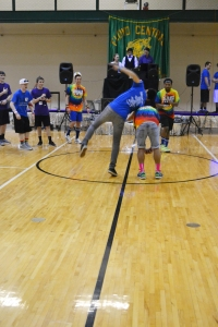 Senior Andrew Sung does a roll over senior Allen Truong during the dance-off by the DJ booth. Photo by Meghan Poff.