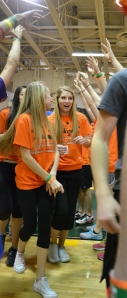 Sophomores Lindsey Suer and Mackenzie Wortham enter the gym for the opening ceremony. Photo by Meghan Poff.