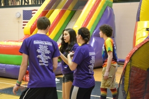 Juniors Hunter Poff, Rachel Nguyen, Dylan Copenhaver,  and Lane Hartman discuss strategy before the Hunger Games tournament. Photo by Meghan Poff.
