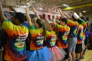 Committee members show their spirit as students enter the gym. Photo by Meghan Poff.