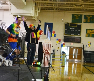 Junior Grant Vellinger and Dance Marathon coordinator Matthew Townsend get the crowd excited at the opening ceremony. Photo by Meghan Poff.
