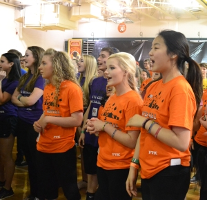 Sophomores Olyvia Hundley, Grace Neal, and Annie Sung prepare to learn the morale dance. Photo by Meghan Poff.