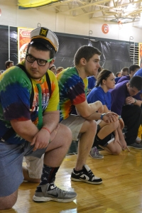 Seniors Josh Becht and Trevor Smith take a knee during the opening ceremony. Photo by Meghan Poff.
