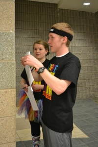 Juniors Emily Naville and Chad Lawrence hang up signs near the registration tables. Photo by Meghan Poff.