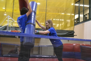 Seniors Jerry La Crosse and Lucy Cathcart attempt to knock one another down with inflatable poles. Photo by Meghan Poff.