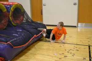Sophomore Logan Bishop races through an inflatable obstacle course. Photo by Meghan Poff.