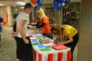 Senior Reese Tarr signs up at the registration table. Photo by Meghan Poff.