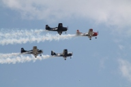 Four of the Trojan Horsemen T-28s return to the show box at Thunder Over Louisville. Photo by Amber Habron.