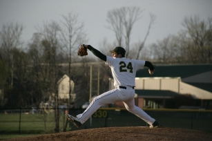 Junior Brandon Smith pitches in the first inning against New Albany. Photo By Noble Guyon.