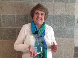 Health aide Earlene King  holds up her Educational Support Employee of the Year award.