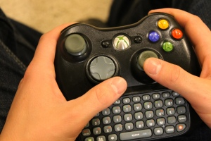 Senior Tylan Davis holds his Xbox 360 controller while playing a game. Photo by  Alaina King.