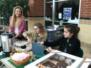 "Juniors Brooke Welsh, Rachel Jones, and Danielle Mooser sell baked goods to help raise money to help buy toys for the Angel Tree children. ""I enjoy working and seeing all the different items and being able to work with friends while doing something good for the community,"" said Mooser."