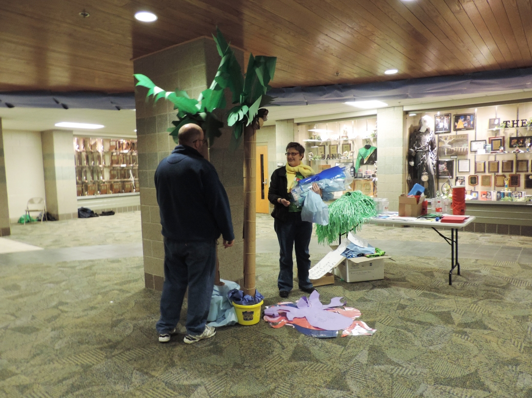 Parent volunteers Don and Melissa Lopp take down the decorations as FCDM comes to an end. Photo by Quinn Fizgerald.