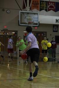 Junior Michael Bolus avoids balls thrown by the opposing team.