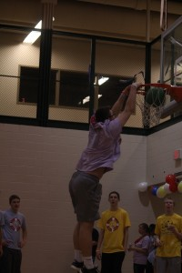 Junior Philip Archer dunks in the warm up round of the dunk contest.