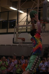 Senior Aiden Cora dunks in the warm up round of the dunk contest.