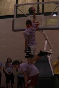 Junior Jordan Stevens dunks over junior Harrison Rice.