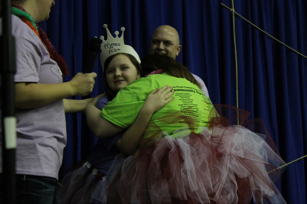 Mickey Deputy hugs Ella McBride after she was crowned FCDM Princess 2015. Photo by Alaina King.