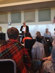 Orchestra director Doug Elmore gives instructions to students before the busses depart.