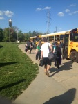 Students load onto the busses for Evansville.