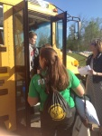 Students file up the bus steps to gain a seat for the ride to Evansville.