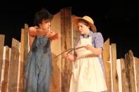 Senior Josh Solomon as Buddy teaches senior Emily Naville as Luella how to use the divining rod. Photos by Jenny North.