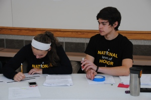 Seniors Olivia Hudson and Hank Duncan gather information for the blood drive.