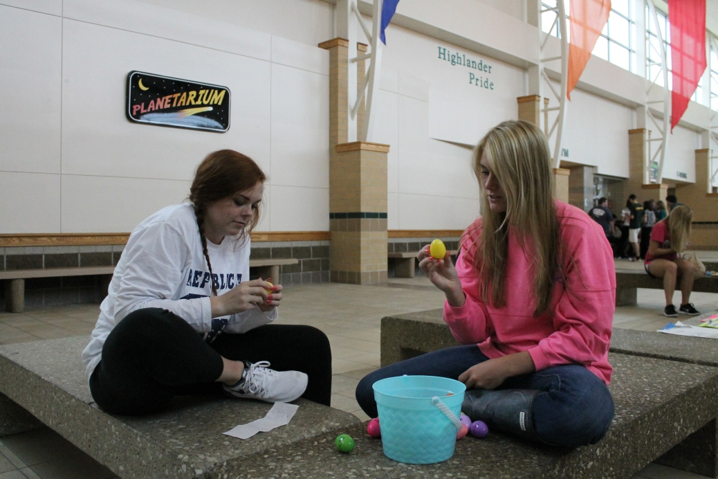 "Seniors Taylor Neagle and Taylor Tuxworth take look over their eggs after the scavenger hunt. ""My favorite part was running around and having fun,"" said Neagle."