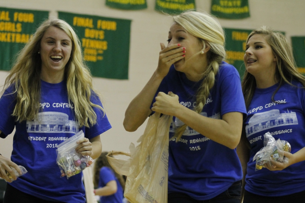 Student Renaissance members  juniors Paige Spiller, Lindsey Suer, and Maddie Baird throw candy out to the student section.