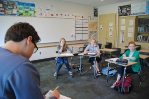 Sophomores Lucas Willman and Grace Reising along with junior Yasmine Frizlen and senior Bridget Cantrell discuss upcoming community service projects on May 11. Photo by Amber Bartley.