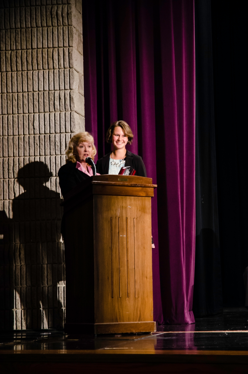 Principal Janie Whaley and senior Erin Patterson stand at the podium smiling after Whaley announces that Patterson is Ms. Floyd Central for the class of 2015. Photo by Robert Wormley.