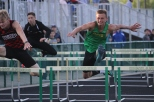 Sophomore Bradley Foster jumps over his last hurdle in the 100 meter hurdles.